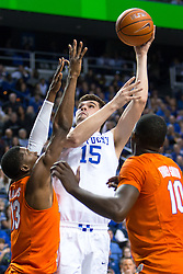 Kentucky forward Isaac Humphries, center, shoots a hook shot with pressure from Florida forward Kevarrius Hayes, left, forward Dorian Finney-Smith in the first half.<br /> <br /> The University of Kentucky hosted the University of Florida, Saturday, Feb. 06, 2016 at Rupp Arena in Lexington .