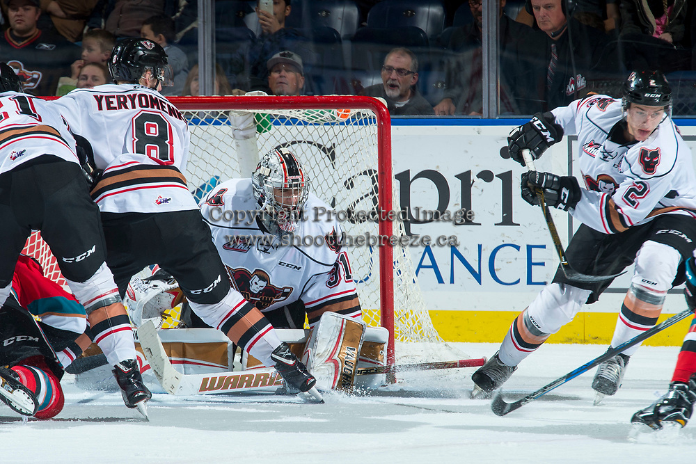 KELOWNA, CANADA - OCTOBER 13: Nick Schneider #31 of the Calgary Hitmen defends the net during second period against the Kelowna Rockets on October 13, 2017 at Prospera Place in Kelowna, British Columbia, Canada.  (Photo by Marissa Baecker/Shoot the Breeze)  *** Local Caption ***