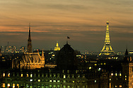 France. Paris. Elevated view on Paris cityscape and the Eiffel tower. Paris. the eiffel tower. the dome of the chambre de commerce. the Invalides. the conciergerie.  view from the roofs of the hotel de ville