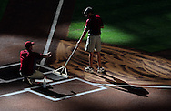 Jun. 18 2011; Phoenix, AZ, USA; Arizona Diamondbacks ground crew members clean home plate prior to the first pitch at Chase Field. The Diamondbacks host the Chicago White Sox.  Mandatory Credit: Jennifer Stewart-US PRESSWIRE.