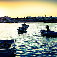 Where: Morocco, Rabat. <br /> A great photo of the old city, river and sunset. I especially enjoy the water texture.