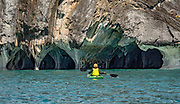 Visit the impressive Marble Chapel Nature Sanctuary (Capillas de Mármol) via popular boat tours from Bahía Manso on General Carrera Lake, near Puerto Rio Tranquilo, Chile, Patagonia, South America. This beautiful Chilean Nature Sanctuary sculpted by water and wind has three main geological formations: the Cathedral, the Chapel, and the Cave. You can join a Marble Caves tour in Puerto Río Tranquilo; or save money and time by driving directly 8 km south to Bahía Manso, via a pot-holed very steep side road, where we spontaneously joined a 2-hour tour boat on short notice. The best time is a sunny summer morning in calmer waters. The side road to Bahía Manso was nervously passable with our 2-wheel-drive compact car, but 4WD might be required to return back up if wet.