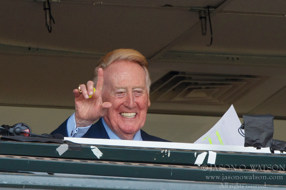 SAN FRANCISCO, CA - OCTOBER 02: Broadcaster Vin Scully acknowledges fans before the game between the San Francisco Giants and the Los Angeles Dodgers at AT&T Park on October 2, 2016 in San Francisco, California. The San Francisco Giants defeated the Los Angeles Dodgers 7-1. (Photo by Jason O. Watson/Getty Images) *** Local Caption *** Vin Scully