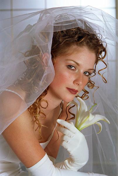 Bride holding a flower portrait