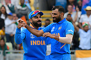 Wicket - Mohammed Shami of India celebrates taking the wicket of Tamim Iqbal of Bangladesh with Virat Kohli (captain) of India during the ICC Cricket World Cup 2019 match between Bangladesh and India at Edgbaston, Birmingham, United Kingdom on 2 July 2019.