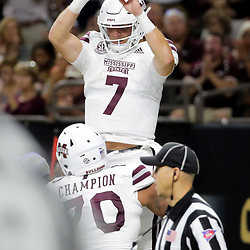 Aug 31, 2019; New Orleans, LA, USA; Mississippi State Bulldogs quarterback Tommy Stevens (7) celebrates with teammate offensive lineman Tommy Champion (70) after a touchdown run during the second quarter against the Louisiana-Lafayette Ragin Cajuns at the Mercedes-Benz Stadium. Mandatory Credit: Derick E. Hingle-USA TODAY Sports