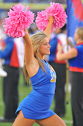 Oct 14, 2010; Lawrence, KS, USA; A Kansas Jayhawks cheerleaders performs before the game against the Kansas State Wildcats at Memorial Stadium. The Jayhawks won 59-7.  Mandatory Credit: Denny Medley-US PRESSWIRE