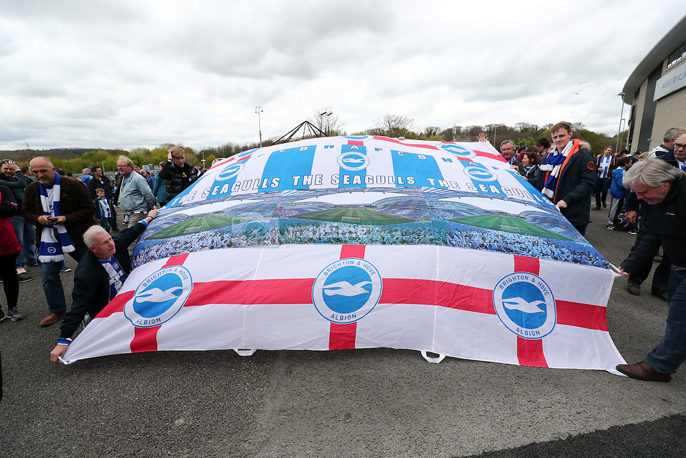 Brighton and Hove Albion fans with a flag before the Sky Bet Championship match at the AMEX Stadium, Brighton.