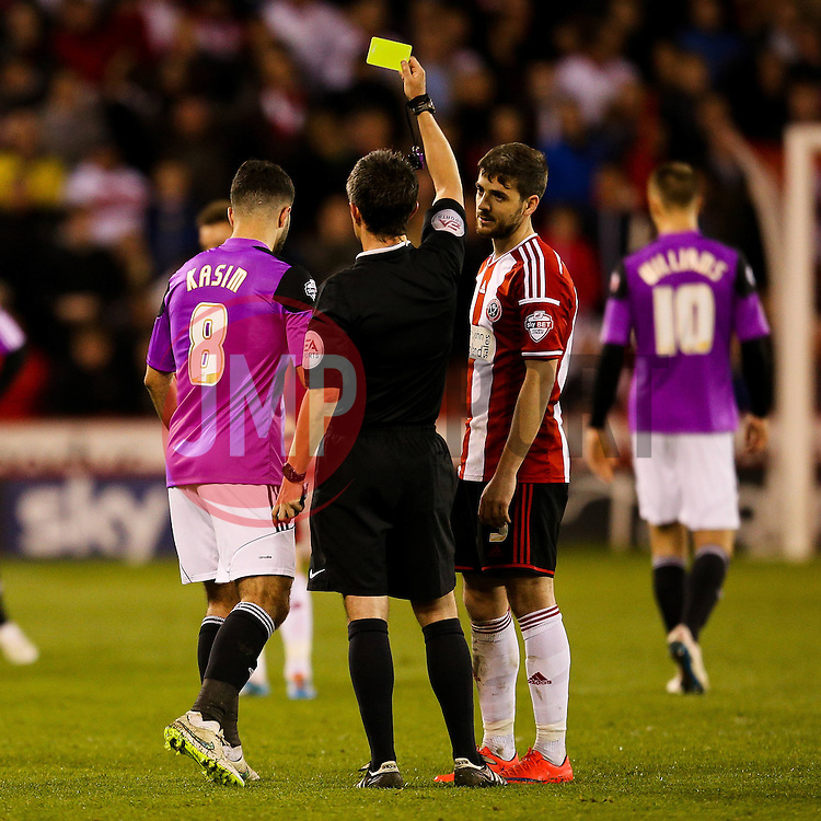 Yaser Kasim of Swindon Town receives a yellow card  - Photo mandatory by-line: Matt McNulty/JMP - Mobile: 07966 386802 - 07/05/2015 - SPORT - Football - Sheffield - Bramall Lane - Sheffield United v Swindon Town - Sky Bet League One