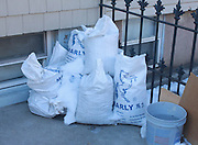 Demo bags in the corner of a front yard in Greenpoint, Brooklyn. Photo by Philippe Theise/NYCity Photo Wire