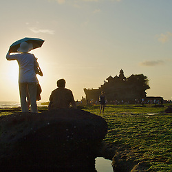 Visitors view a Balinese temple in Indonesia. Tanah Lot seaside temple is one of Bali's most important Hindu temples.