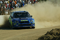 Norway's driver Petter Solberg and British co-driver Phillip Mills control their Subaru Impreza in the Loelle Special Stage on the first day of the Rally of Sardinia, Italy, October 1, 2004.