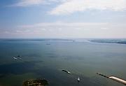 Nederland, Amsterdam, IJburg, 25-05-2010. Vuurtoreneiland met Luwtedam, IJmeer gezien vanuit Waterland, met in het midden Pampus,  Almere aan de horizon. Er zijn plannen om Almere verder uit te breiden en in het IJmeer te gaan bouwen. Ook aanleg van een IJmeerverbinding (IJmeerbrug) wordt overwogen..IJmeer (IJsselmeer) seen to Almere (at the horizon). There are plans to further expand Almere in the IJmeer. Also the construction of a 'IJ-connexion' (bridge) is considered..luchtfoto (toeslag), aerial photo (additional fee required).foto/photo Siebe Swart