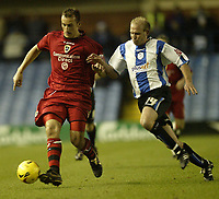 Photo: Aidan Ellis.<br /> Sheffield Wednesday v Cardiff City. Coca Cola Championship. 25/11/2006.<br /> Cardiff's Ricardo Scimeca shields the ball from Wednesday's John Hills