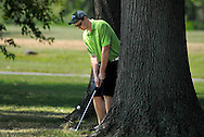 1 AUG. 2011 -- ST. LOUIS -- Ryan Fitzgerald, a student at CBC High School, chips onto the third green from a group of trees while playing a round of golf through The First Tee of Greater St. Louis at the Highlands Golf & Tennis Center in Forest Park Monday, Aug. 1, 2011. The program is designed to help young golfers. Photo © copyright 2011 Sid Hastings.