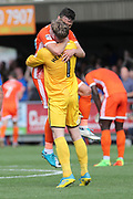 Shrewsbury Town defender James Bolton (13) celebrates withn Shrewsbury Town goalkeeper Dean Henderson (1) after win during the EFL Sky Bet League 1 match between AFC Wimbledon and Shrewsbury Town at the Cherry Red Records Stadium, Kingston, England on 12 August 2017. Photo by Matthew Redman.