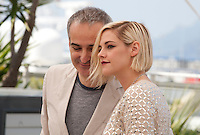 Director Olivier Assayas and Kristen Stewart at the Personal Shopper film photo call at the 69th Cannes Film Festival Tuesday 17th May 2016, Cannes, France. Photography: Doreen Kennedy