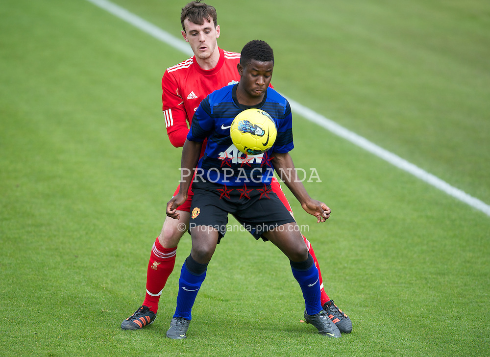 KIRKBY, ENGLAND - Thursday, April 19, 2012: Liverpool's Jack Robinson in action against Manchester United's Larnell Cole during the FA Premier Reserve League match at the Kirkby Academy. (Pic by David Rawcliffe/Propaganda)