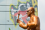 A golden statue of martyred Archbishop Oscar Romero stands against a comic billboard on a  high rise office building at the Plaza El Salvador Del Mundo (Savior of the World) where preparations are being made for Saturday's ceremony and mass announcing the beatification of Archbishop Oscar Romero. The Archbishop was slain at the alter of his Church of the Divine Providence by a right wing gunman in 1980. Oscar Arnulfo Romero y Galdamez became the fourth Archbishop of San Salvador, succeeding Luis Chavez, and spoke out against poverty, social injustice, assassinations and torture. Romero was assassinated while offering Mass on March 24, 1980.