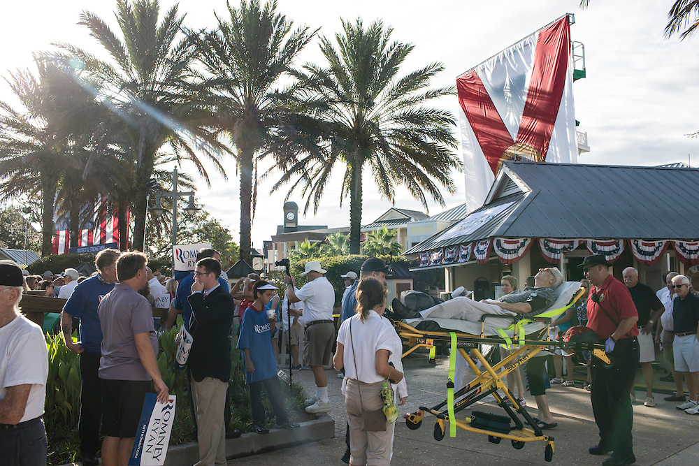 A man is taken away on a stretcher before a campaign rally with Republican Vice Presidential candidate  Rep. Paul Ryan (R-WI) on Saturday, August 18, 2012 in The Villages, FL.