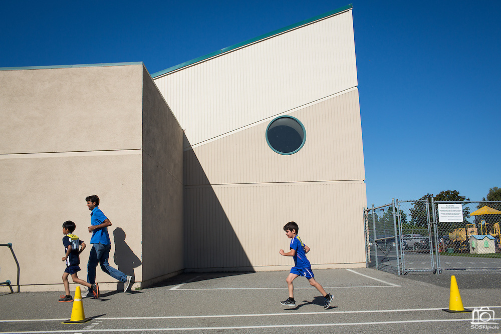 Students and parents participate in a Run for Fun fundraiser at Zanker Elementary School in Milpitas, California, on April 30, 2016.  The proceeds will be used to build shade structures over the playground. (Stan Olszewski/SOSKIphoto)