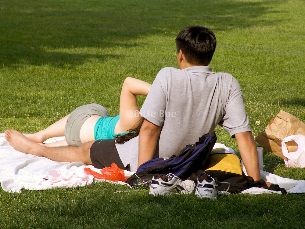 young couple relaxing in the park