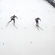 The start of the Semi Final of the Women's Sprint Free, from left, Ji-Soo Shin, Korea, Sarah Murphy, New Zealand, Maria Devydenkova, Russia and Justyna Kowalczyk, Poland,, during the Cross Country Sprint Competition at Snow Farm, New Zealand during the Winter Games. Wanaka, New Zealand, 14th August 2011. Photo Tim Clayton