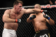 "LONDON, ENGLAND, JUNE 7, 2008: Antoni Hardonk (left) misses his mark against Eddie Sanchez during ""UFC 85: Bedlam"" inside the O2 Arena in Greenwich, London on June 7, 2008."