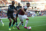 Burnley forward Jay Rodriguez (19) holds off Liverpool defender Joel Matip (32) during the Premier League match between Burnley and Liverpool at Turf Moor, Burnley, England on 31 August 2019.