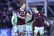 5 Aaron Hughes congratulates 6 Christophe Berra for scoring winning goal during the William Hill Scottish Cup 4th round match between Heart of Midlothian and Hibernian at Tynecastle Stadium, Gorgie, Scotland on 21 January 2018. Photo by Kevin Murray.