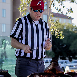 Nov 3, 2018; Baton Rouge, LA, USA; Tanner Dawson of New Orleans, Louisiana wears an referee costume while tailgating   prior to kickoff of a game between the LSU Tigers and the Alabama Crimson Tide at Tiger Stadium. Mandatory Credit: Derick E. Hingle-USA TODAY Sports