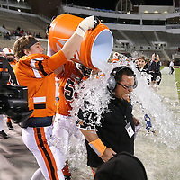 Adam Robison   BUY AT PHOTOS.DJOURNAL.COM<br /> Calhoun City Head Coach Perry Liles has water dumped on him at the end of the fourth quarter of the MHSAA Class 2A Football State Chanpionship where his team defeated Bay Springs 22-8 Friday in Strakville.