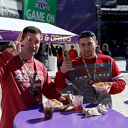 Feb 3, 2013; New Orleans, LA, USA; San Francisco 49ers fans Drew Fussell and Corey Jean pose for a photo in a fan plaza before Super Bowl XLVII against the Baltimore Ravens at the Mercedes-Benz Superdome. Mandatory Credit: Derick E. Hingle-USA TODAY Sports