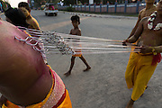 Ahsoura Festival, Shitte Muslim man with hooks and lines in his back leading traditional procession to temple, Mawlamyine