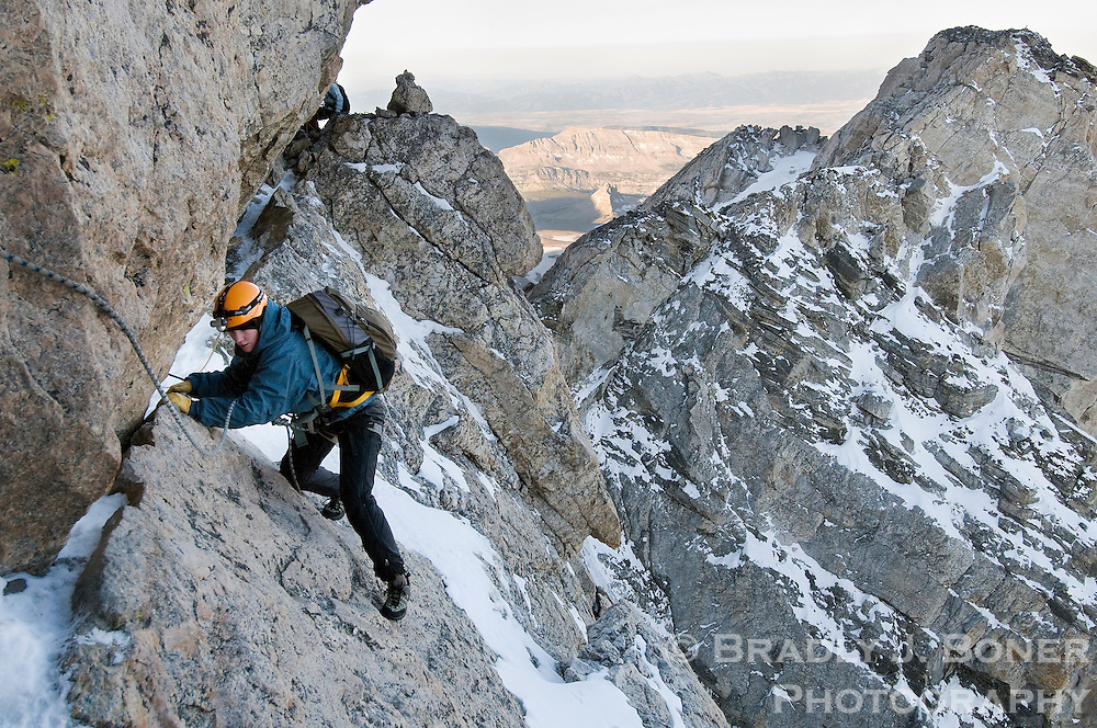 "NEWS&GUIDE PHOTO / BRADLY J. BONER.Courtney Campbell of Jackson makes her way through ""The Crawl"" section of the Owen-Spalding route on the Grand Teton while ascending the peak Sept. 14. Campbell retraced the route climbed by her great-great grandfather, Frank Peterson, with fellow climbers William Owen, Franklin Spalding and John Shive on the first confirmed ascent of the peak in August 1898."