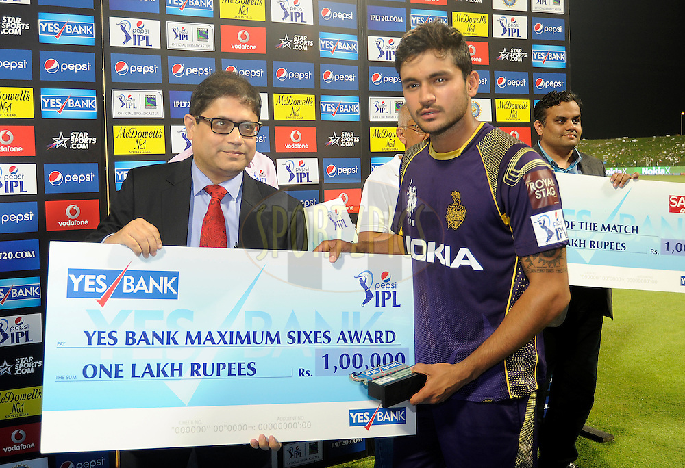 Manish Pandey of the Kolkata Knight Riders receives the Yes Bank maximum sixes award during the presentation after match 19 of the Pepsi Indian Premier League 2014 Season between The Kolkata Knight Riders and the Rajasthan Royals held at the Sheikh Zayed Stadium, Abu Dhabi, United Arab Emirates on the 29th April 2014<br /> <br /> Photo by Pal Pillai / IPL / SPORTZPICS