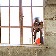 We visited a school in Amboseli and had a chance to play with the children. This little boy was shy and peeked through the window instead.<br />