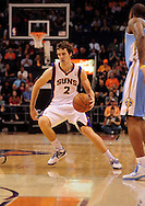 Oct. 22 2010; Phoenix, AZ, USA; Phoenix Suns guard Goran Dragic (2) handles the ball during the first half against the Denver Nuggets during a preseason game at the US Airways Center. The Nuggets defeated the Suns 144 - 106. Mandatory Credit: Jennifer Stewart-US PRESSWIRE.