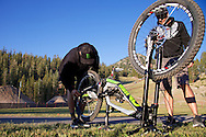Cam and Howie work on the bike early in the Day in the life of Cam Zink as he prepares for the Mammoth Backflip for World of X Games at Mammoth Mountain, CA. © Brett Wilhelm