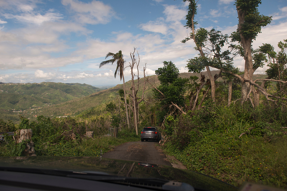 Comerio, PR, November 11, 2017--Driving in areas hardest hit by Hurricane Maria can be slow. Roads are passable, but many are still partially blocked by   debris, mud slides, and fallen trees and powerlines. Photo by Lori Waselchuk