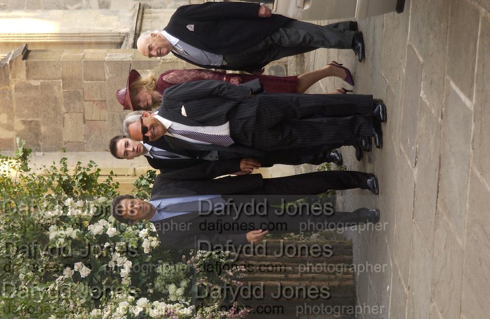 Imran Khan and Taki, Wedding of Ben Goldsmith and Kate Rothschild, St. Mary's church, Bury St. Edmunds, Suffolk. 20 September 2003. © Copyright Photograph by Dafydd Jones 66 Stockwell Park Rd. London SW9 0DA Tel 020 7733 0108 www.dafjones.com