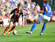 AFC Bournemouth's Simon Francis on the ball during the Sky Bet Championship match between Bournemouth and Birmingham City at the Goldsands Stadium, Bournemouth, England on 6 April 2015. Photo by Mark Davies.