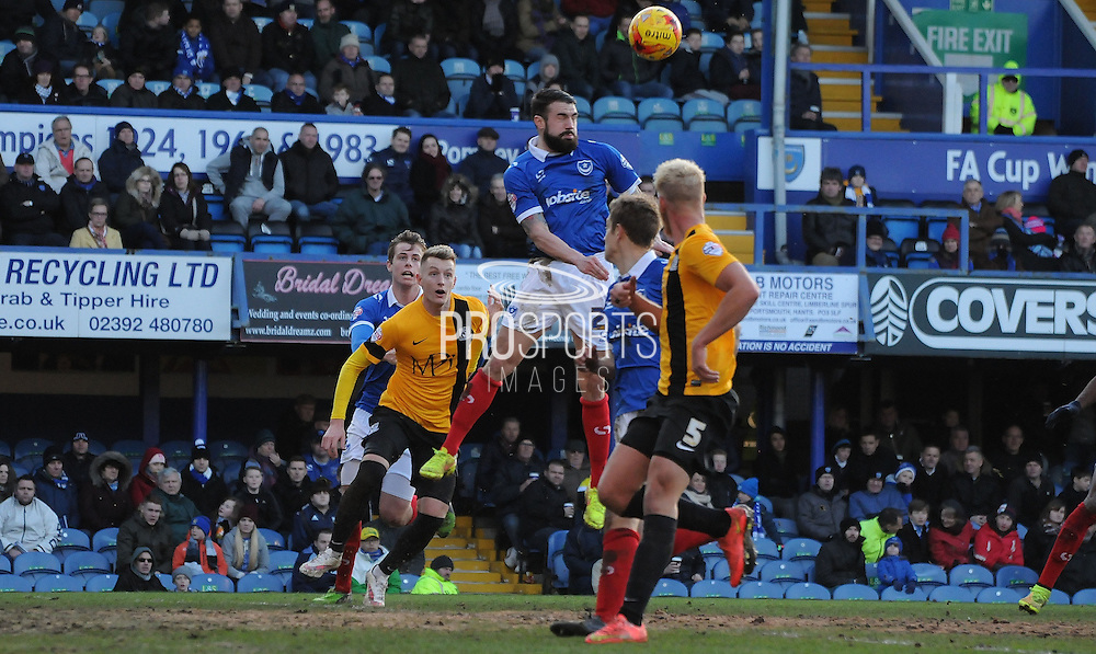James Dunne heading clear the danger during the Sky Bet League 2 match between Portsmouth and Southend United at Fratton Park, Portsmouth, England on 24 January 2015. Photo by Michael Hulf.