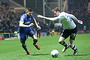 Leeds United midfielder Stuart Dallas (15) Preston North End striker Tom Barkhuizen (29) during the EFL Sky Bet Championship match between Preston North End and Leeds United at Deepdale, Preston, England on 10 April 2018. Picture by Craig Galloway.