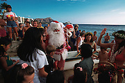 Santa Claus arriving at Waikiki Beach, Oahu, Hawaii, ( editorial use only )<br />