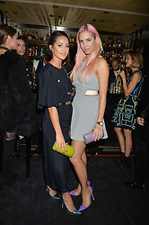 Left to right, ROXIE NAFOUSI and AMBER LE BON at a private dinner for designer Ethan K held at Blakes Hotel, 33 Roland Gardens, London on 26th October 2016.