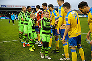 The respect handshake during the Vanarama National League match between Forest Green Rovers and Torquay United at the New Lawn, Forest Green, United Kingdom on 1 January 2017. Photo by Shane Healey.