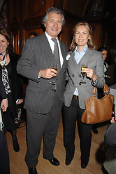 ARNAUD & CARLA BAMBERGER at a party to celebrate the publication of 'Seven Secrets of Successful Parenting' by Karen Doherty and Georgia Coleridge, held at Chelsea Town Hall, King's Road, London on 28th April 2008.<br />
