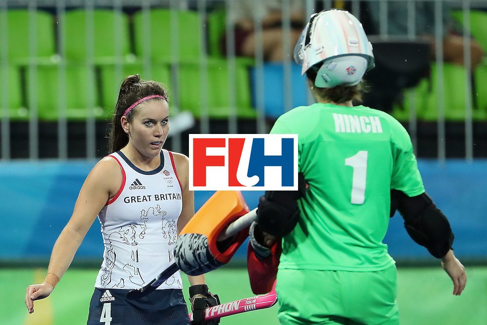 RIO DE JANEIRO, BRAZIL - AUGUST 15:  Laura Unsworth #4 of Great Britain celebrates with goalkeeper Maddie Hinch #1 after defeating Spain 3-1 in the quarter final hockey game on Day 10 of the Rio 2016 Olympic Games at the Olympic Hockey Centre on August 15, 2016 in Rio de Janeiro, Brazil.  (Photo by Christian Petersen/Getty Images)