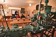 Staff Sgt. Robert Galusha, tutors students in English in a cold unheated vehicle maintenance classroom at Lyceum vocational school.  The in-residence vocational school is home for more than 200 local boys and girls, ages 14-18. Here, they are taught the basics in high demand skills for the Bishkek region. The training in tailoring, mechanics, agriculture and services allow the children, who in most cases were abandoned, orphaned or simply poor; a better opportunity to gain employment in the local economy. Manas Air Base Outreach Society is a non-profit organization established at Manas Air Base in December 2003. Lyceum is one of its several focus groups that have donated more than 17,000 man-hours, $65,000 and 40,000 pounds of donations to heart operations, heating fuel, construction projects, elderly stipends, trips, and daily administration costs. Staff Sgt. Galusha, a Baltimore, MD native is deployed to the 376th Expeditionary Logistics Readiness Squadron, Manas Air Base, Kyrgyz Republic, from the 175th Wing, Maryland ANG. (U.S. Air Force photo/Master Sgt. Lance Cheung)<br />